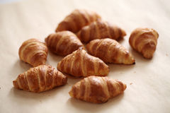 Fresh french croissants on a tablecloth Royalty Free Stock Photo