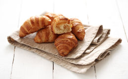 Fresh french croissants on a tablecloth Royalty Free Stock Photography