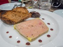 Fresh French foie gras. Goose liver in delicate restaurant, served on white dish with jam and bread Stock Photography