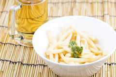 Fresh french fries with beers Stock Images