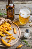 Fresh french fries served with beer Royalty Free Stock Photography