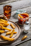 Fresh french fries served with cold drink Stock Image