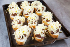 Fresh french rolls loaded with cheese and chicken livers Royalty Free Stock Photography