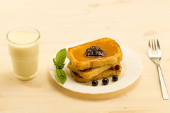 Fresh french toast with honey and jam on a white plate with berries. Stock Photo