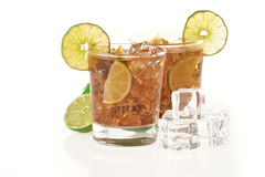 Fresh Fresh cocktail with cola drink and lime fruit Stock Photos