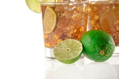 Fresh Fresh cocktail with cola drink and lime fruit Royalty Free Stock Image