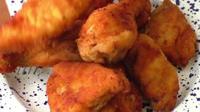 Fresh fried chicken on plate stock video footage