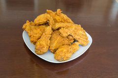 Fresh Fried Chicken on Shiny Table Stock Images