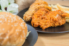 Fresh, fried chicken strips. On a wooden table Stock Image