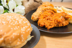 Fresh, fried chicken strips. On a wooden table Royalty Free Stock Photo