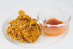 Fresh, fried chicken on a white plate Stock Images