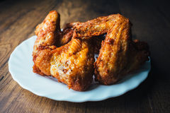 Fresh fried chicken on a white plate set on a wood table. Still Life Photography Stock Photography