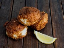 Fresh fried fish cakes. Served with lemon Royalty Free Stock Photography
