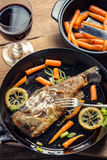 Fresh fried fish served with red wine Royalty Free Stock Image