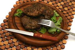 Fresh fried hamburger and dishware. On plate Royalty Free Stock Photo