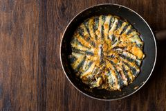 Fresh Fried Sardines in Pan on Wooden Surface. Traditional Food Stock Image