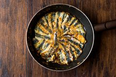 Fresh Fried Sardines in Pan on Wooden Surface. Traditional Food Royalty Free Stock Photography