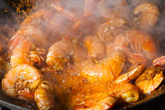 Fresh fried shrimps with smoke Royalty Free Stock Photos