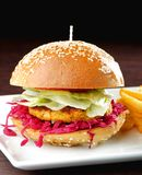 Fresh and fried vegetarian/fish burger Stock Image