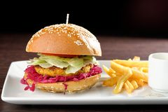 Fresh and fried vegetarian/fish burger Royalty Free Stock Image