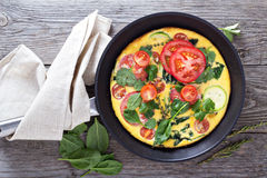 Fresh fritatta with zucchini and tomatoes Stock Images