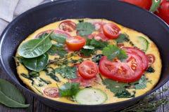 Fresh fritatta with zucchini and tomatoes Stock Image