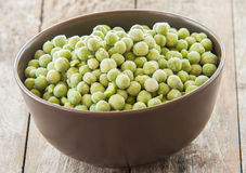 Fresh frozen peas in bowl Royalty Free Stock Image