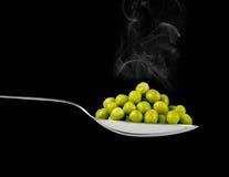 Fresh frozen peas on spoon Royalty Free Stock Image