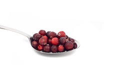 Fresh frozen red berrys on metal spoon Royalty Free Stock Photos