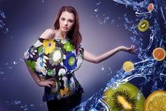 Fresh fruit. Young woman showing fresh fruit royalty free stock photography