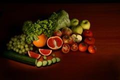 Fresh fruit. On dark wood table Royalty Free Stock Image