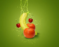 Fresh Fruit. Fresh banana, mandarins, cherry,  with water splashes on green background Royalty Free Stock Photo