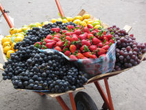 Fresh Fruit. A lot of produce is sold by vendors on the street in Ecuador.  This photograph was made in Otavalo, Ecuador, in July, 2012.  It shows large Stock Photo