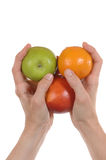 Fresh fruit. Some fresh fruit in womans hand in front of white background Stock Photography