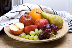 Fresh fruit. A collection of fresh and washed organic fruits arranged in rustic still life setting stock image