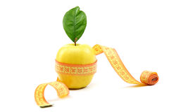 Fresh fruit apple with green leaf and measuring tape. Stock Photos