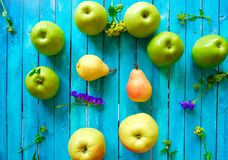 Fresh fruit apples and pears on a blue background Stock Image