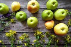 Fresh fruit apples and pears on a brown background Royalty Free Stock Photography