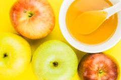 Fresh fruit background for Rosh Hashanah. Rosh Hashanah, apples and cup of honey on yellow background. close up stock image