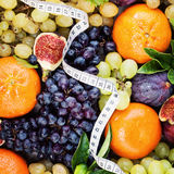 Fresh Fruit Background with White Measuring Tape Royalty Free Stock Image