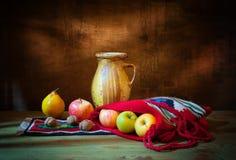 Fresh fruit in the bag, ceramic jar stock photography