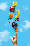 Fresh fruit balancing on a human hand. Royalty Free Stock Images
