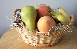 Fresh fruit basket Stock Images