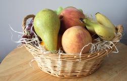 Fresh fruit basket Stock Images
