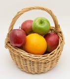 Fresh fruit in basket. Isolated Royalty Free Stock Photos