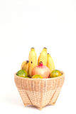 Fresh fruit. In the basket against a white background Stock Images