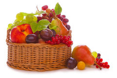 Basket with fresh fruits. Fresh fruit basket on white background.Basket with fresh fruits royalty free stock photography