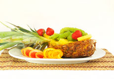 Fresh fruit beautifully sliced on plate. Stock Photos