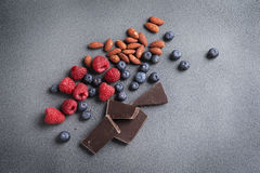 Fresh Fruit Berries Chocolate and Nuts Stock Photo