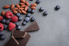 Fresh Fruit Berries Chocolate and Nuts Royalty Free Stock Photos